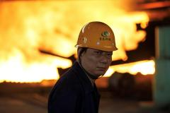China's slowdown deepens; industrial output growth falls to 17-1